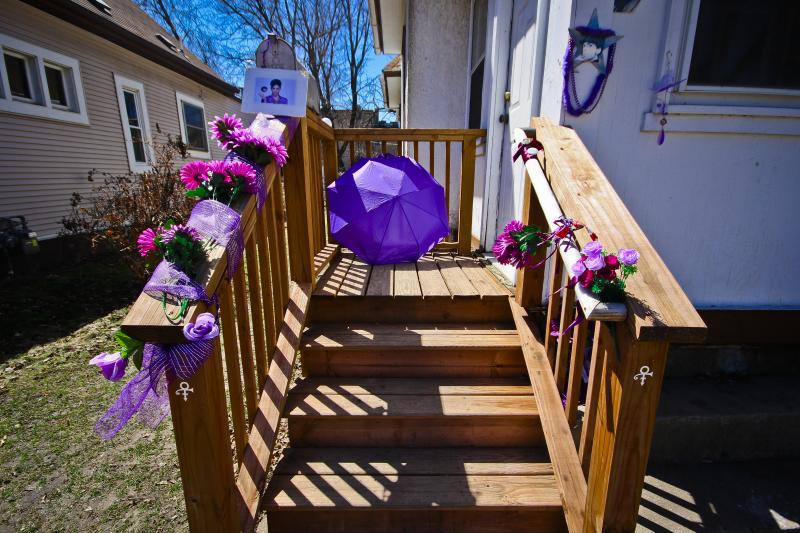 Mementos left on the front stairs to the Purple Rain house, 2018