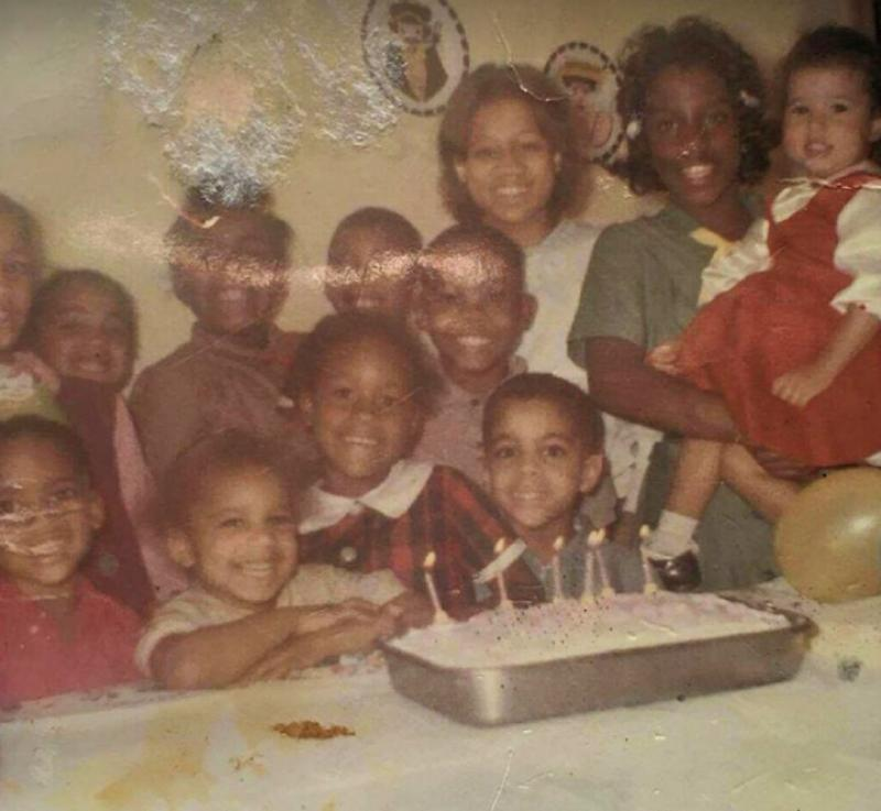 Prince (fourth from the left, first row) at a family birthday party, mid-1960s