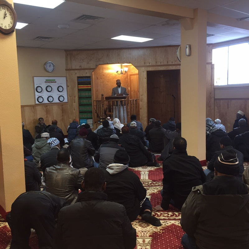 Imam Sharif Mohamed leads the Friday prayer at Dar Al-Hijrah Mosque, 2016