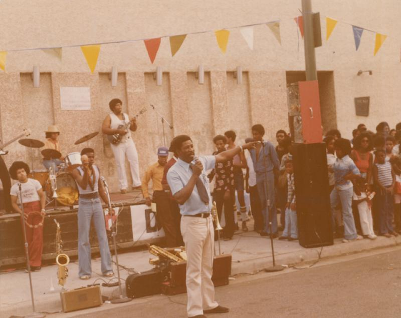 The band Cohesion performing outside The Way, 1970s