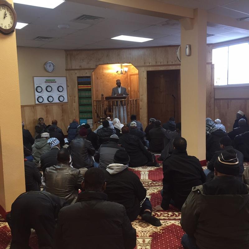 Imam Sharif Mohamed leads the Friday prayer at Dar Al-Hijrah Mosque, 2016