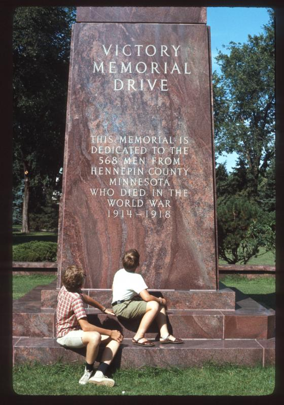 Two Minneapolis children observing the monument to Victory Memorial Drive at the park's North End.